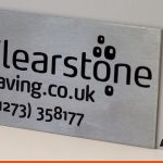 Engraved plaque with company logo and branding