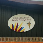 Printed and oval shaped sign for local primary school