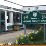 Primary School shaped sign on posts by entrance