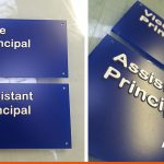 Tactile sign for Collyers with raised lettering | Horsham