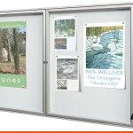 This dual door notice board for indoor use with magnetics to hold posters in place