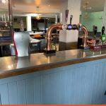 Protective wrap onto bar top for Crawley Pub | Health & Safety
