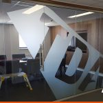 Large logo on office glass in etch vinyl film