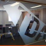 Large logo on office glass in etch vinyl film