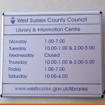 Informative sign with opening times and website details