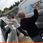 Our install team working on van graphics on-site | BEL