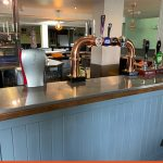 Protective wrap onto bar top for Crawley Pub | Health & Safety