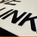 Die pressed lettering